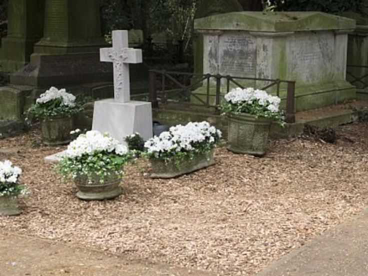 George Michael's grave seen for first time at Highgate Cemetery