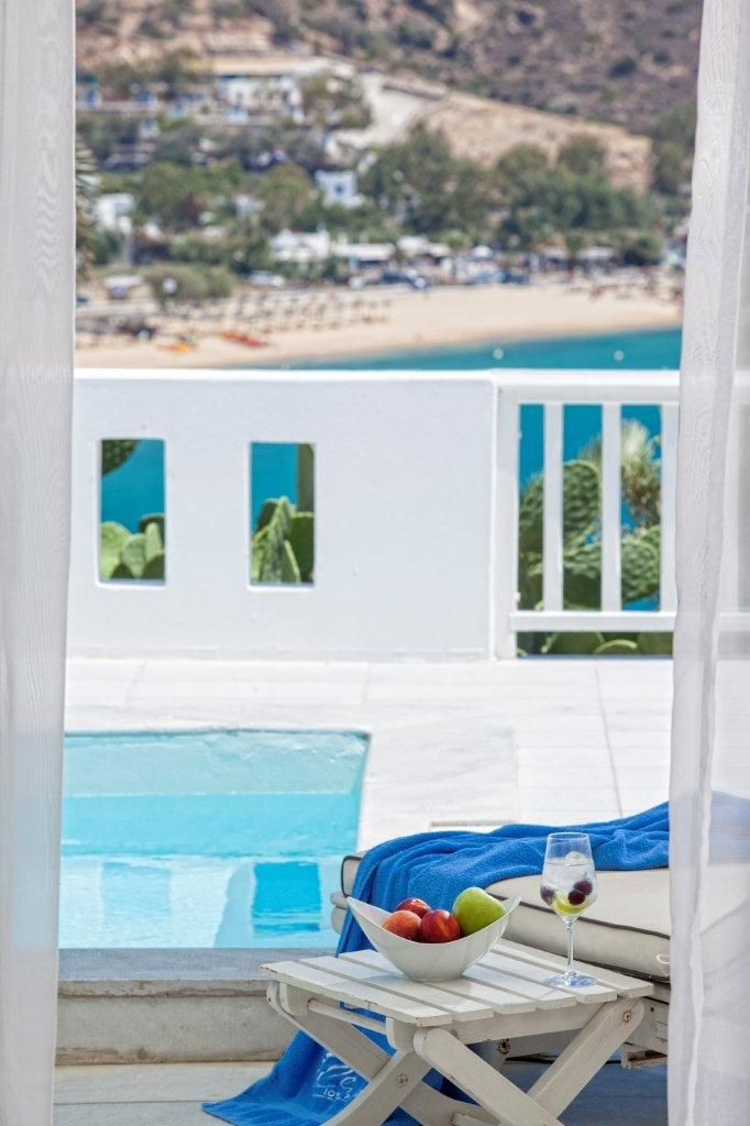 #IosPalace #Hotel & #Spa is the epitome of Cycladic beauty condensed in a bright white microcosm at the edge of Mylopotas bay on #Ios #island #Greece. Open your eyes wide and drift away for a brief flight over the golden, sandy beach. You are surrounded by impressive, hip, elegant designs in perfect harmony with luxurious details and exclusive services. Meet the hotel's #offer here: http://www.tresorhotels.com/en/offers/203/ios-palace-the-most-exclusive-holidays-in-ios