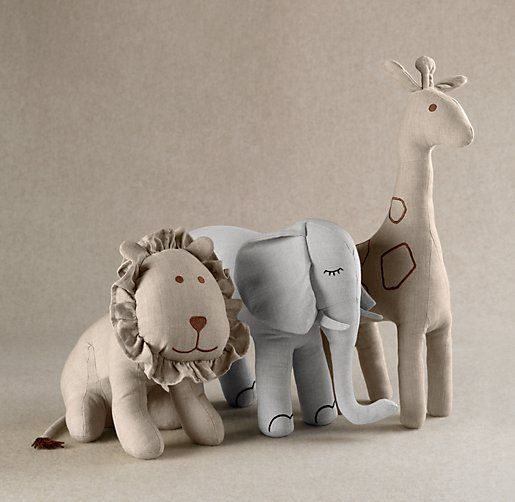 perfect for our nursery theme! Restoration Hardware Giraffe and Lion stuffed toys in neutral colors