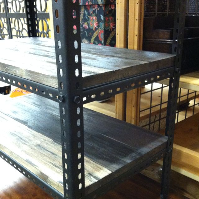 metal shelving unit upcycled with wood shelves.