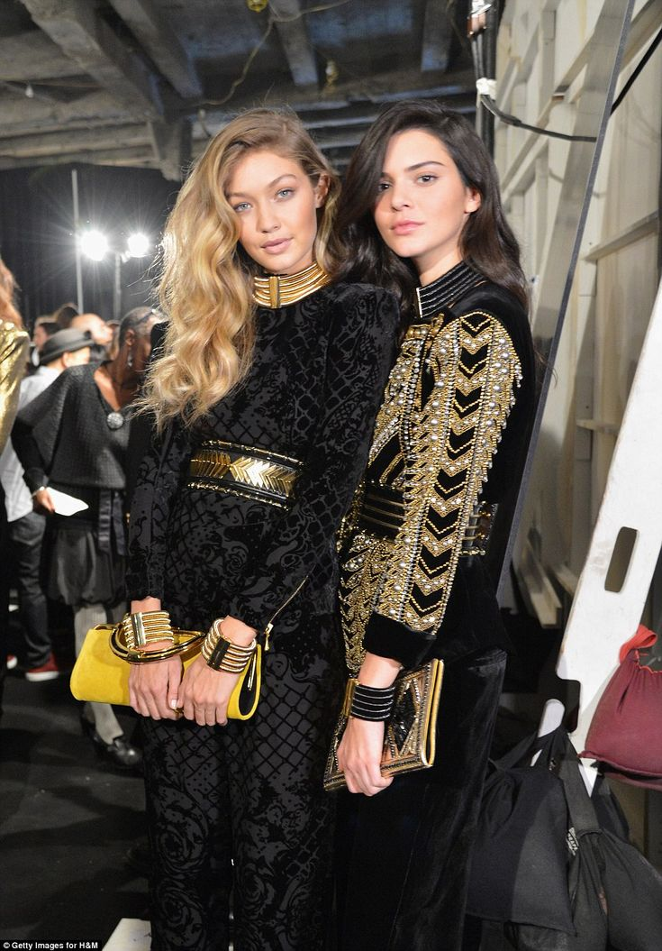 Model best friends, Gigi Hadid and Kendall Jenner, don the label's signature embellished garments before taking to the runway to show off their wares