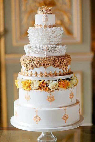 Elaborate Gold & White Wedding Cake.