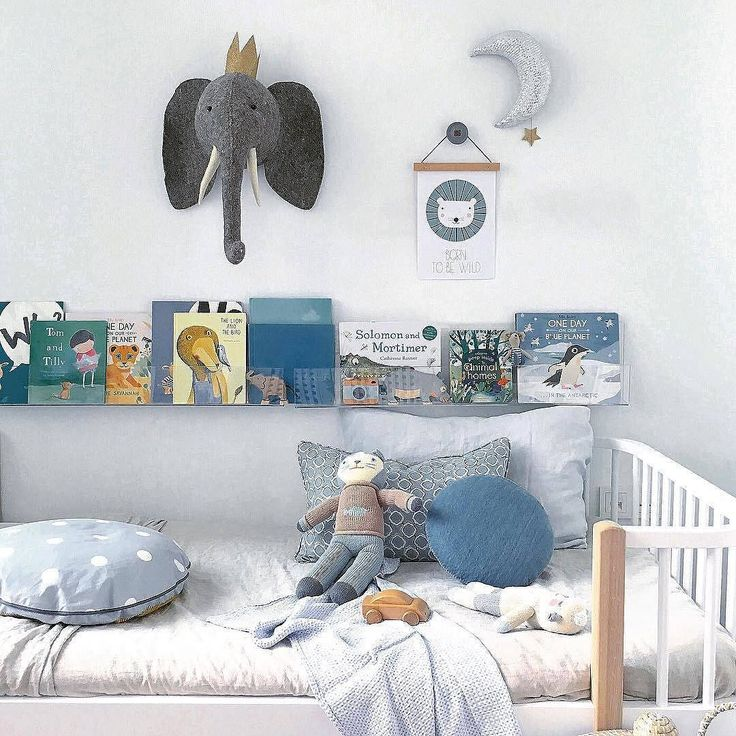 Love this little room full of blues that perfectly match & the book shelf next to the bed.