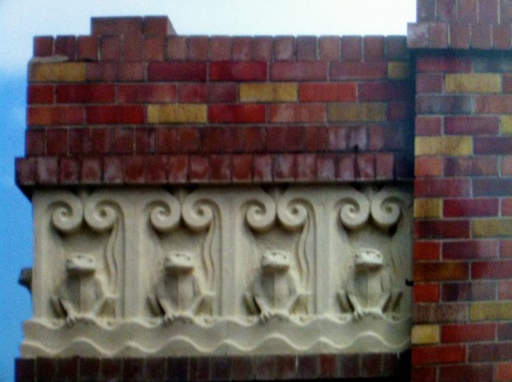 Art Deco detail of frogs on the façade of the North Sydney Pool