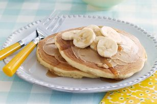 Fluffy Buttermilk Pancakes Recipe - Peanut butter and bananas for breakfast!  Try this favourite combo on fluffy pancakes with a drizzle of maple syrup for a great start to your day.