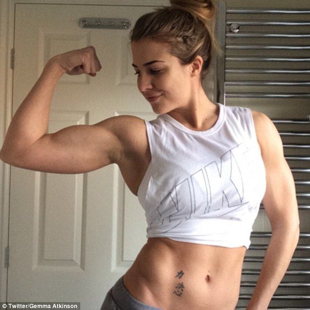 ABSolutely fabulous: Gemma Atkinsondisplayed her bulging biceps and toned six-pack as she flexed in front of the camera in a post-gym snap on Friday morning