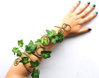 My latest design here I have made a poison ivy accessory, tree people fancy dress slave bracelet hand wrist cuff, a slimmer more delicate style version of the long arm cuff. Any Enquiries please put country and date needed by with any other info you require answered Thank you  ORDERING Pick from the drop down list above which colour vine you would like,  (In these pictures the Ivy leaves are Mid green, the vine in these pictures are mid green)  Every part of this item is made and put…