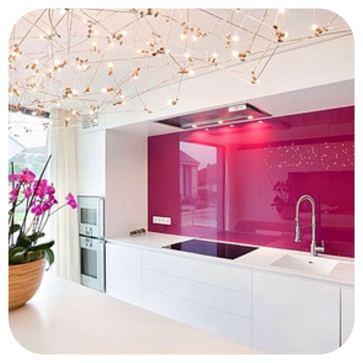 Pink Splashbacks create a great feature wall. Very modern.