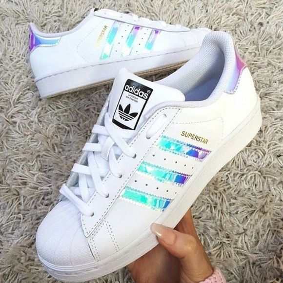 Last one • Adidas Superstar Iridescent Stripe New adidas superstars girls grade school trainers in iridescent stripes. Colors are white/white/metallic silver. The stripes changes color at different angles with hues of pink, blue, purple, silver. Depending on which angle you're looking at it from. • These are BIG KIDS size 5, which is equivalent to women 7, respectively. Adidas holographic superstars Adidas Shoes Sneakers