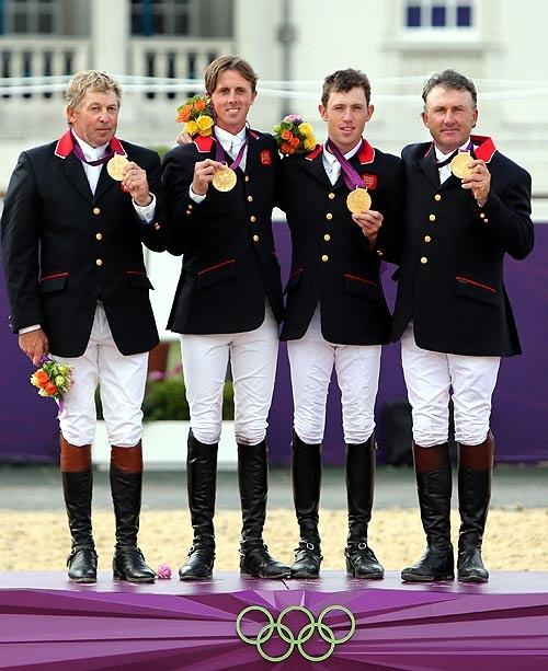 Gold medalists Nick Skelton, Ben Maher, Scott Brash and Peter Charles of Great Britain celebrate