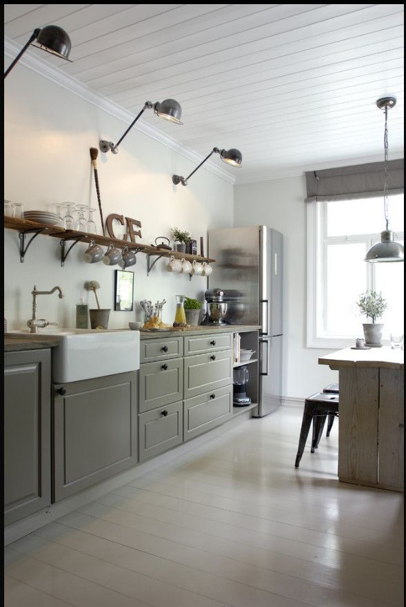 I love the wall lights!  Gorgeous Modern Country kitchen
