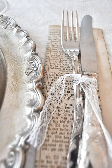 Cute vintage inspired silver and lace table setting.