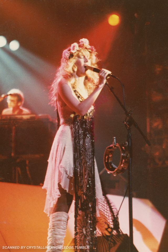 Stevie  ~ ღ☆❤☆ღ ~   onstage,  sublimely beautiful, wearing her iconic beaded black tunic and a crown of fresh flowers; photo taken during her 'Bella Donna' tour, 1981; love her leg warmers too ~ https://en.wikipedia.org/wiki/Bella_Donna_(album)