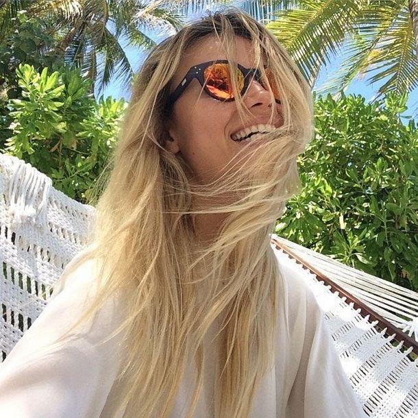 Natasha Poly sharing a huge and mesmerizing smile whit her Vitesse Blue w/Orange mirrored lens by Spektre Sunglasses
