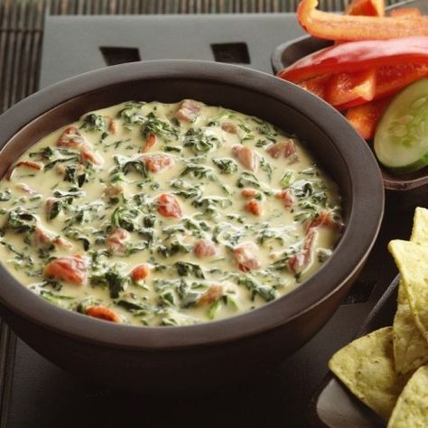 Queso dip recipe where chilies bring the heat while cheese, spinach and bacon assist on special teams for a potluck score.    Velveeta®, Philadelphia® and Oscar Mayer® are registered trademarks of Kraft Foods, Inc. Ro*Tel® is a registered trademark of ConAgra Foods RDM, Inc.