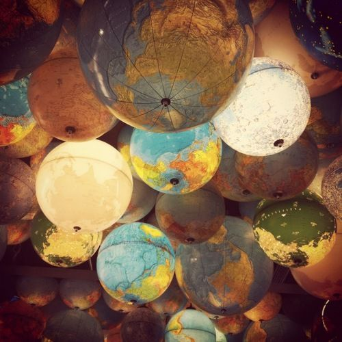 Love this! lanterns from old globes.