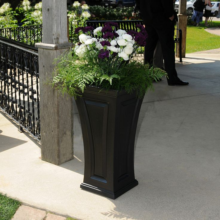 The Cambridge Tall Planter offers you a blend of modern and traditional design. The curved shape creates a unique and classy look, providing a beautiful accent to the entrance of any home. Features a single-wall, molded design with high-grade polyethylene construction. Includes a self-watering tray insert that creates a sub-irrigation water system to encourage root growth. The tray can be reversed to support a potted plant or removed so the planter can be completely filled with soil. Made in…