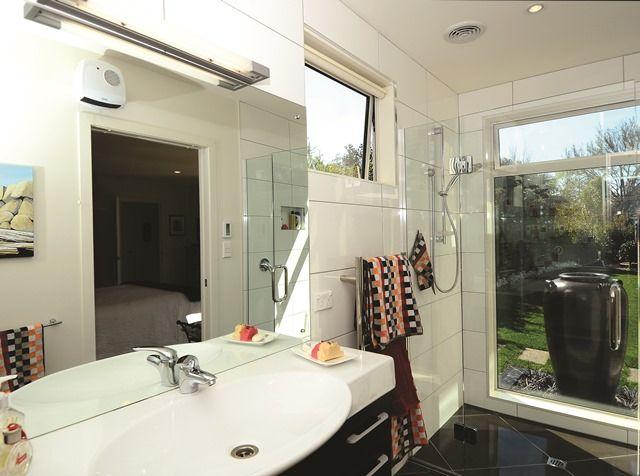 The master bedroom en suite enjoys its own garden vista.