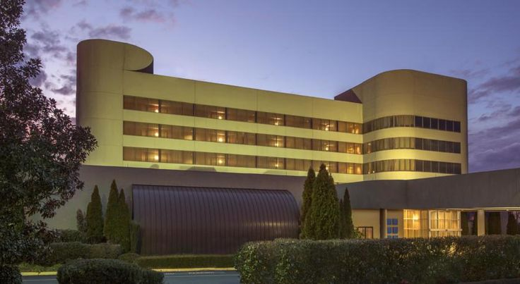 Hilton Charlotte Executive Park Charlotte This hotel is 6 miles from downtown Charlotte, North Carolina and Charlotte-Douglas International Airport. It offers free airport shuttle services, an on-site restaurant and rooms with a 37-inch flat-screen TV.