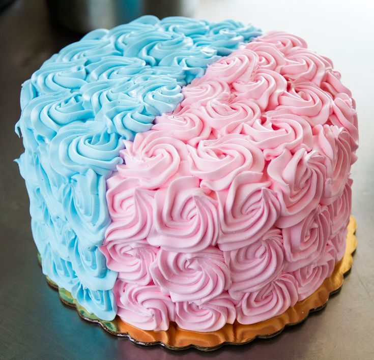 a pink and blue rosette cake that s prefect for a gender reveal