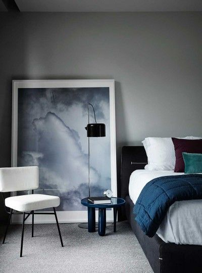 Add Moody Elegance To A Contemporary Bedroom Setting With A Light Palette
