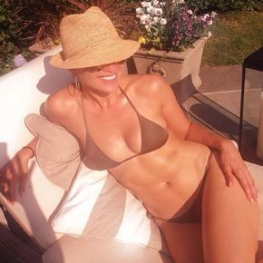 "Jennifer Lopez appears to be aging in reverse as the 45-year-old pop star showed off her incredible figure in a brown skimpy bikini. Her BFF Leah Remini clearly agrees, as the King Of Queens star couldn't help but take this poolside snap of her age-defying friend -- who went on to post the photo on Instagram. ""She yelled at me ""DONT MOVE!"" Another shot by Remini... #shemakesmelaugh #notmad #loca #loveher #shesgettinggoodatthis,"" J. Lo captioned the snap on July 21, 2014."