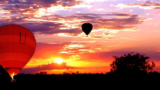 Float silently over the rugged West MacDonnell Ranges as the sun rises and experience one of the most popular Australian outback adventures with Outback Ballooning. Alice Springs, Northern Territory Australia.