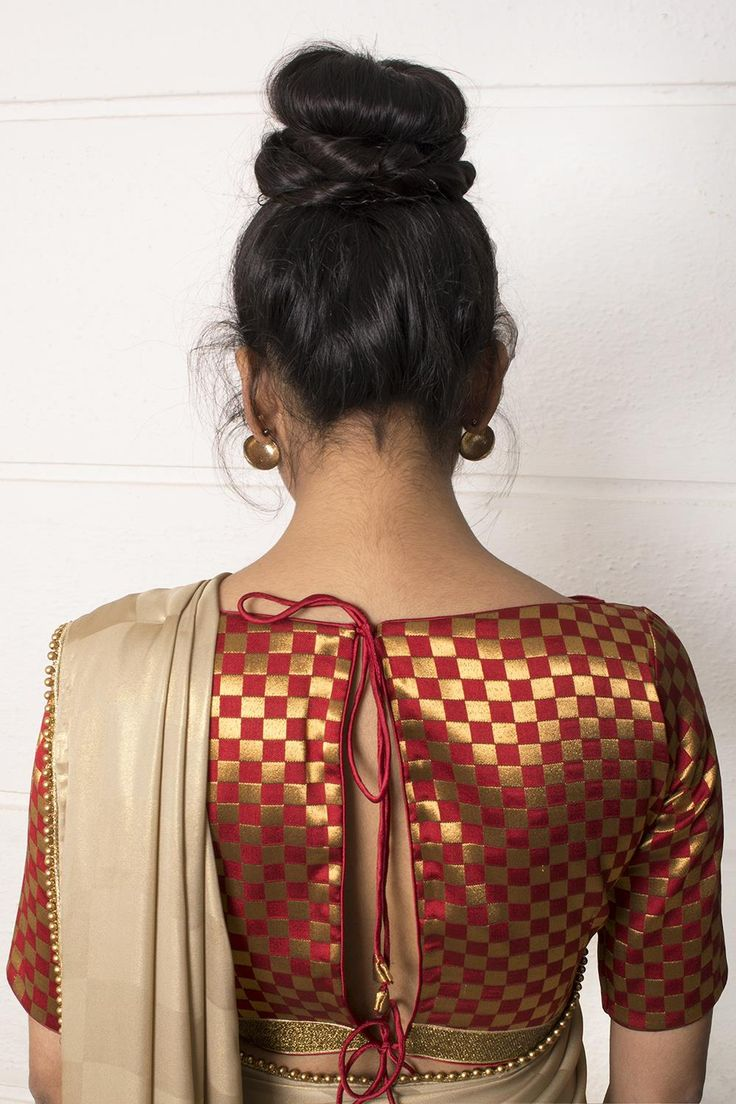 DESCRIPTION: Check out this unusual brocade checked blouse in a subtly bold red and gold combination, complete with a classic boat neck silhouette and a double tie back. Make a fiery fashion statement by teaming with a black or gold saree. Whatsapp +91 81050 68601. *Shipping worldwide* #saree #blouse #sareeblouse #blousedesigns #desi #indianfashion #india #bollywood #red #gold #brocade