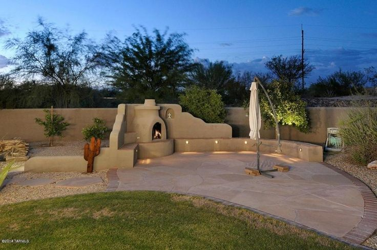 Southwestern Patio with exterior stone floors, Fence, outdoor pizza oven