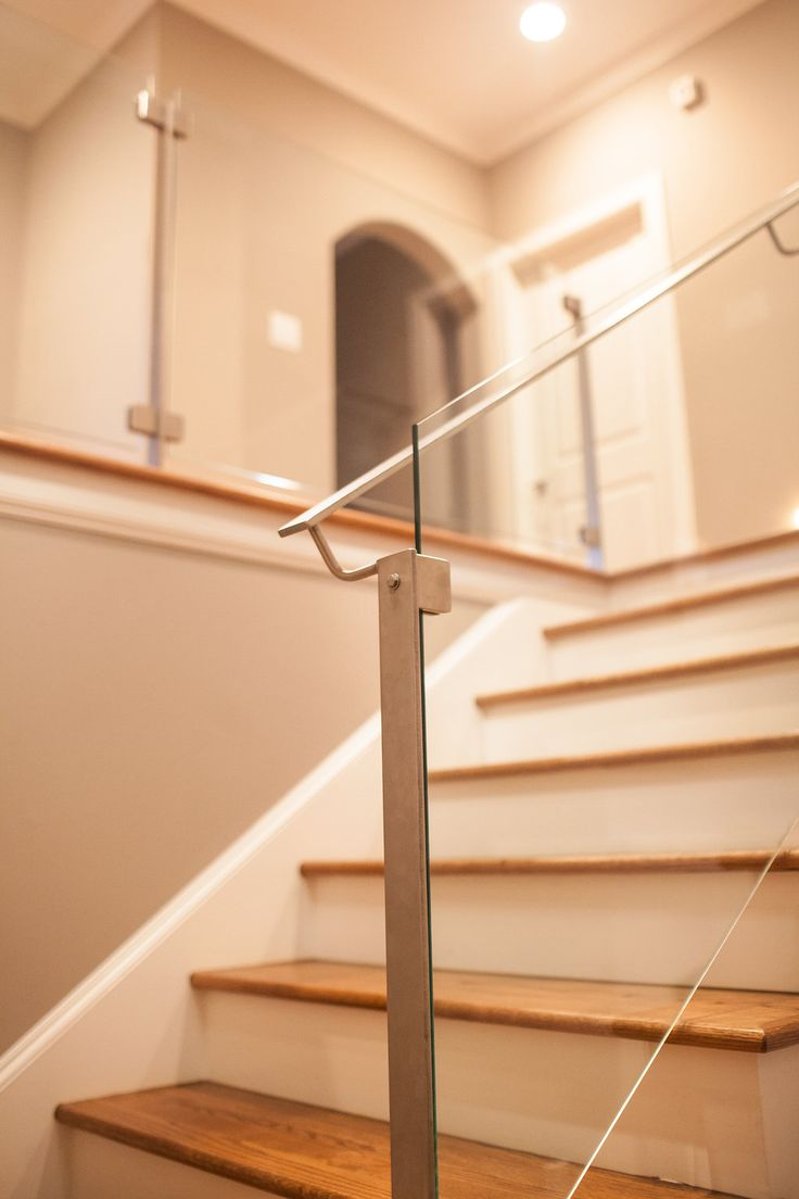 Stainless steel posts and glass railings for stairs
