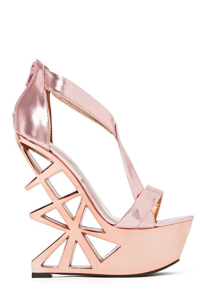 Privileged Disco Nights Platform Unleash your inner Studio 54 goddess in these totally awesome rose gold platforms featuring geometric-inspired cutouts at heel and a strappy front. Fully lined, cushioned sole. Zip closure at back.