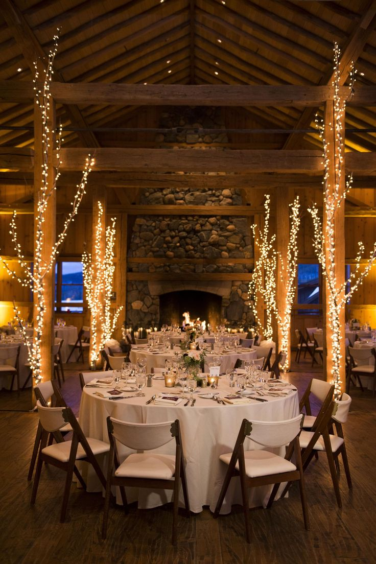 ideas for rustic wedding reception%0A Lodge wedding  white lights  tree d  cor  rustic elegance  indoor reception