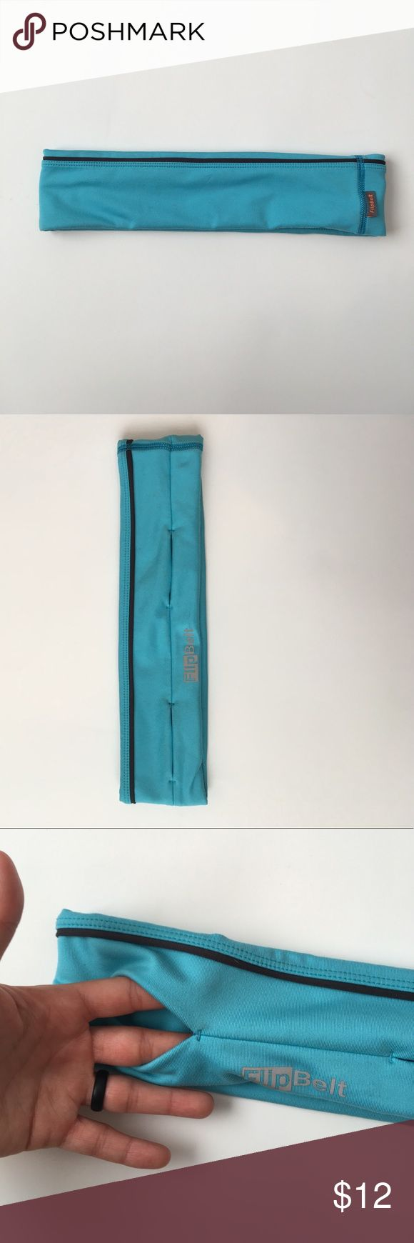 Flip belt Flip Belt • Blue • Medium • Holds key, phone, ID, etc. • small spots (see pics) • if you have questions ask them! This is great for runs, hikes, or being out and about! I have loved using this and being able to be hand free! flip belt Other
