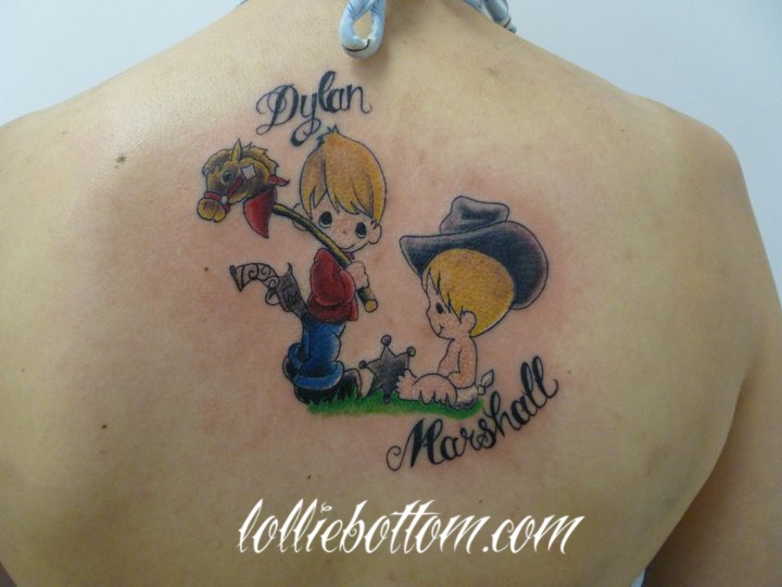 custom precious moments characters with her son's names by lollie national award winning tattoo artist  precision body art : tulsa, ok  www.lolliebottom.com