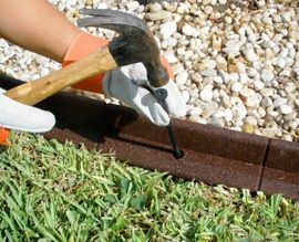 Eco-Border Landscape Edging.  It's a no-dig, bendable and durable landscape edging that is made of recycled tires.