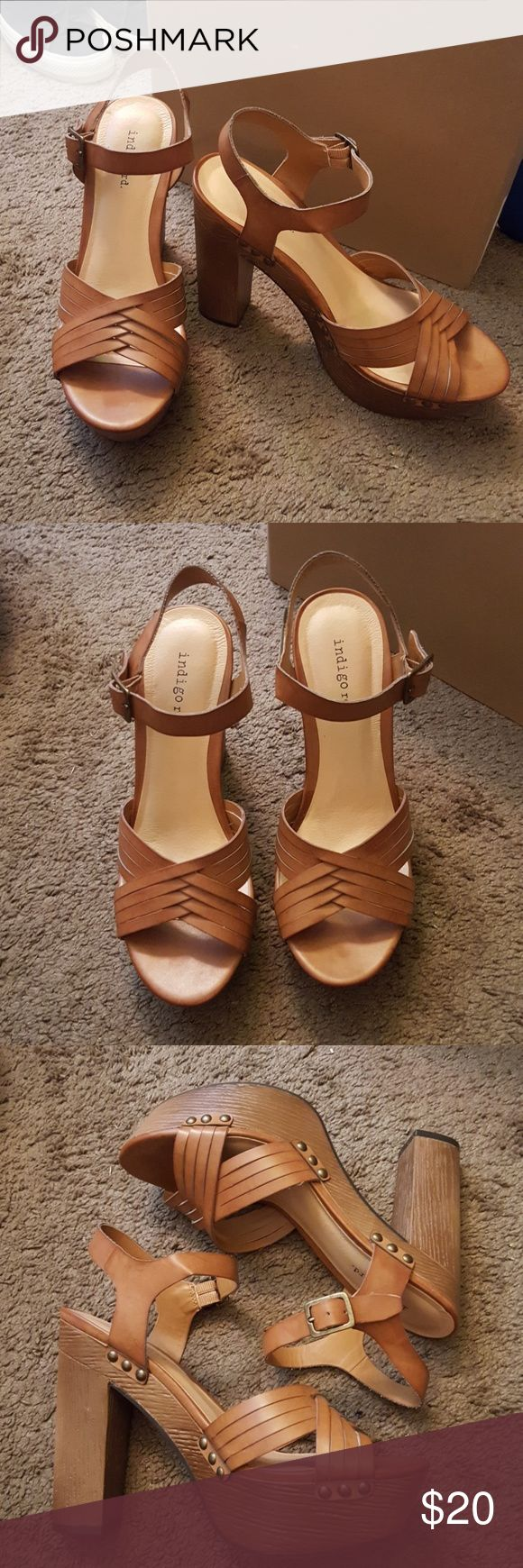 NWOT indigo rd. Tan High Heels Shoes Size 7.5 NWOT indigo rd. Tan Block High Heels Shoes Size 7.5 ( 7 1/2). New and never worn. Material is like a fake leather. Color is a tan/brown. Cute block high heel! I believe this style is called Irkaily. indigo rd. Shoes Heels