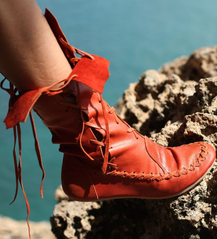For anyone looking for something bright and bold, these gorgeous orange ankle boots are the ideal solution to bring sunshine into your life. Feel fantastic and brighten up your day with a splash of gorgeous orange colour. With delicate lacing throughout, these beautiful ankle boots are a must have accessory this season.