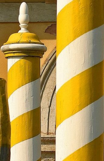 Love these bright yellow and white stripe columns!