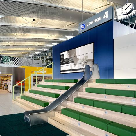 The departure lounge at Amsterdam's Schiphol airport includes a slide to keep children occupied while they wait