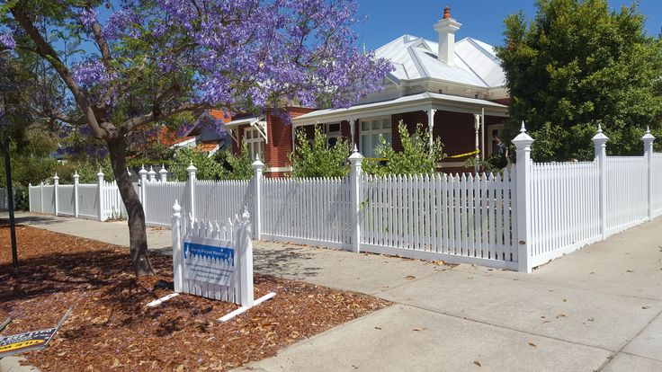 cathedral picket fence with angelina capitols and plinths