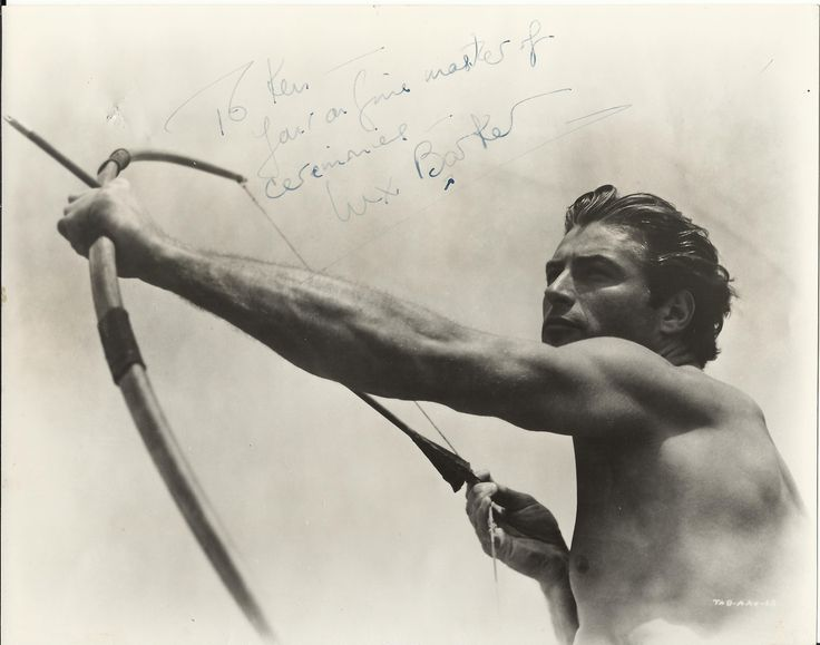 BARKER LEX: (1919-1973) American Actor, remembered for his portrayal of Tarzan of the Apes. Vintage signed and inscribed 9.5 x 7.5 photograph of Barker in a head and shoulders pose, aiming a bow and arrow, in a scene from one of his Tarzan movies. Signed in blue fountain pen ink to a clear area at the head of the image, 'To Ken - Your (sic) a fine master of ceremonies - Lex Barker'.