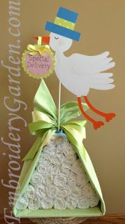 Stork diaper bundle for a baby shower centerpiece/gift