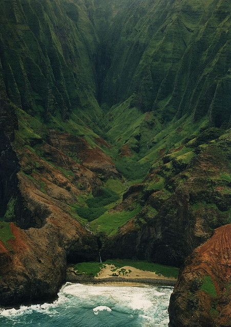 "Na Pali coast, Hawaii. The Na Pali coast is one of the most photogenic & ruggedly beautiful coatslines in the world. 50 hikers per day can hike to this beach & camp a maximum of 5 days. (take a min. of 8 hours to hike). only Hawaiin Royalty were allowed here in the past. This location was used in the movie ""King Kong"" by Ted Jones"
