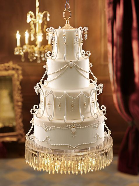 Wedding cake inspired by a vintage chandelier & this cake floats--it's suspended from the ceiling! Now that's elegant!