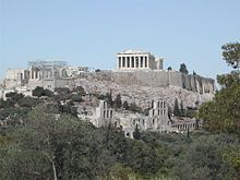 """There is no doubt that the great GREEK tragedies and comedies performed at the ACROPOLIS were a part of the cult of DIONYSUS. But, there has been a lot of debate about the origins of theater itself. According to some sources, it started with the actor THESPIS, because of whom we use the word """"thespian"""", who performed his roles standing on a cart almost a century earlier.  (Acropolis of Athens)"""