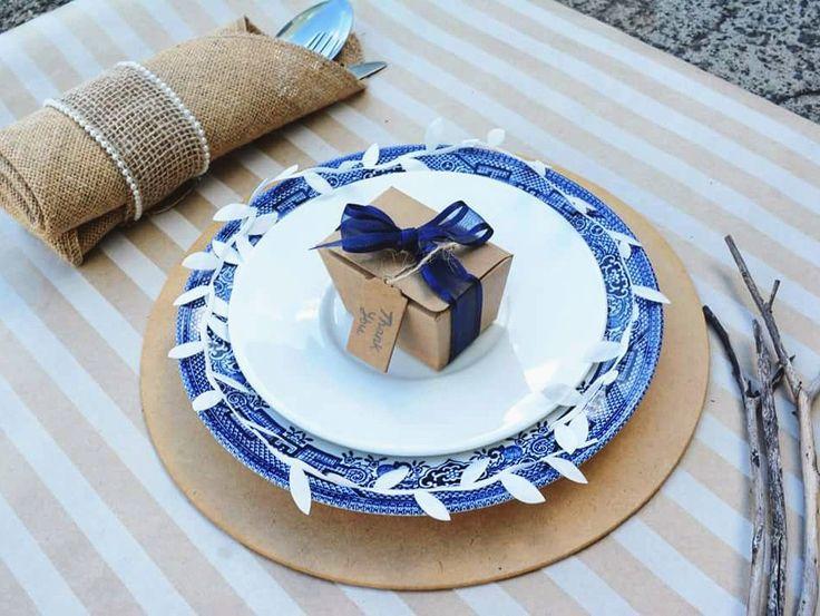 A rustic navy theme: Tiny brown Kraft Ballotin box   #Weddingdecore #Rusticwedding #weddingideas #weddinginspiration #DIY #Bonbonnieres #Cutlery #Ribbons #Barama #Navywedding #chinaplates #Weddingstyling