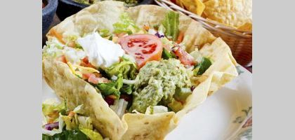 A taco salad following this recipe is a twist on the traditional taco salad.