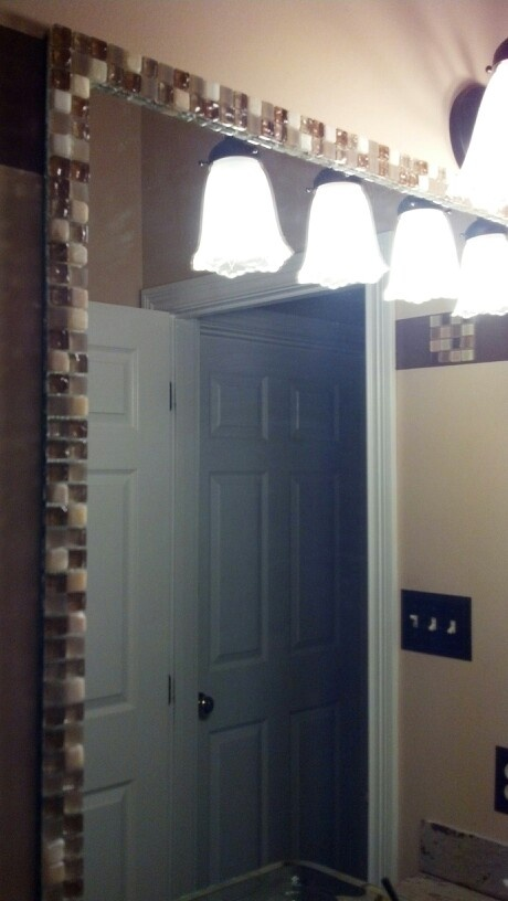 framed bathroom mirror with left over tiles from kitchen it only took 2 18x18 tiles