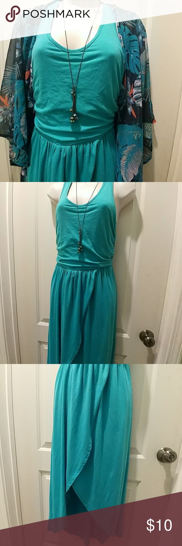 """🌠 Vanity turquoise high-low maxi dress Vanity turquoise high-low maxi dress, Size small Fully lined beneath Shortest length measures 30"""" long Never worn  30% off a bundle of three or more items Everything is negotiable Smoke free home Pet free home All items deserve a 2nd chance at happiness Currently not trading Vanity Dresses High Low"""
