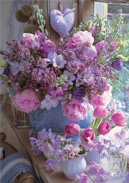 a beautiful indoor display of flowers, anyone reminded of Beatrix Potters cottage here